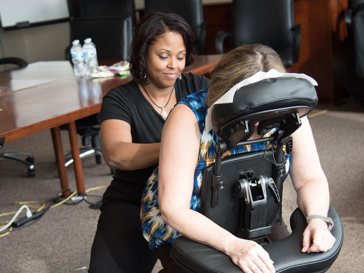 Spa Flow employee doing Office Chair Massage