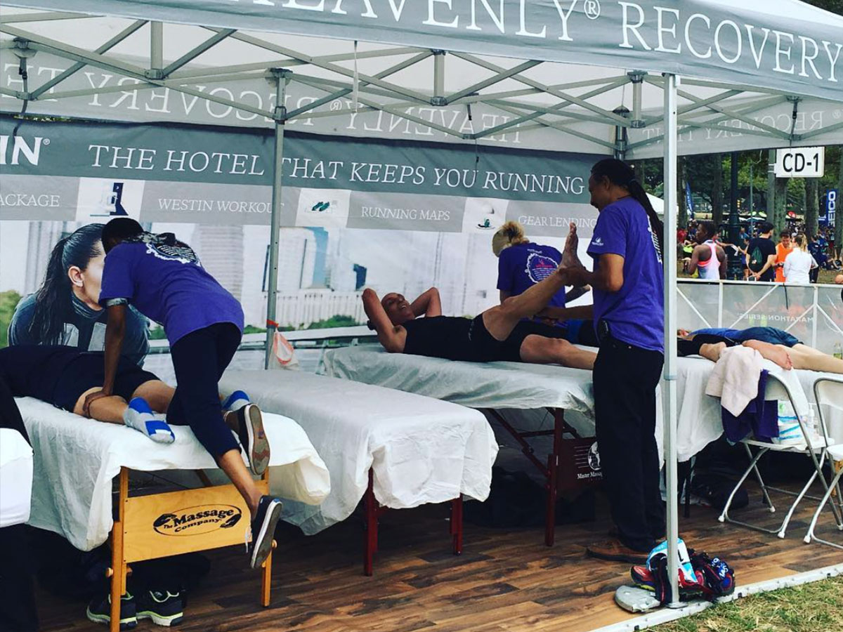 Spa Flow employees doing massages at an event