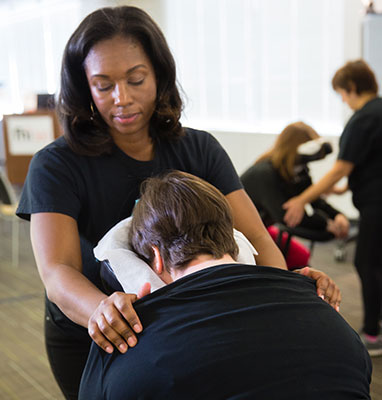 Spa Flow massage therapists doing corporate chair massage at a business
